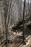 """Switzerland. Canton Ticino. Novaggio. Alfonso Passera, director of Malcantone Tourism, and Andrea Freiermuth walk on the """"Sentiero delle Meraviglie"""" which is a walking path. The """"Sentiero delle Meraviglie"""" is a guided trail which is plunged into nature, but every so often signs of human activity appear. Novaggio is located in the Malcantone area. 16.03.2010 © 2010 Didier Ruef"""