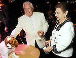"""David McKeithan and Helen Shaffer look at one of the cuter auction items at the Theatre Under the Stars """"Night of a Thousand Stars"""" benefitting TUTS at the Hobby Center Friday April 23,2010.. (Dave Rossman Photo)"""