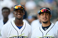 Gerson Molina, left, and Jose Butto of the Columbia Fireflies pose for a photo in a game against the Rome Braves on Saturday, August 17, 2019, at Segra Park in Columbia, South Carolina. Rome won, 4-0. (Tom Priddy/Four Seam Images)