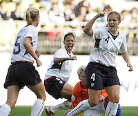 Nov 2, 2006: Suwon, South Korea:  USWNT defender (4) Cat Whitehill celebrates a goal by teammate (5) Lindsey Tarpley  during the Peace Queen Cup at Suwon World Cup Stadium. The US defeated the Netherlands, 2-0.
