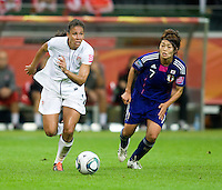 Shannon Boxx (7) of the United States springs past Kozue Ando (7) of Japan during the final of the FIFA Women's World Cup at FIFA Women's World Cup Stadium in Frankfurt Germany.  Japan won the FIFA Women's World Cup on penalty kicks after tying the United States, 2-2, in extra time.