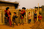 Mien villagers northern Thailand women in traditional costume  and the children in western clothes. 1990s