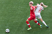June 21, 2015: Sophie SCHMIDT of Canada and Lara DICKENMANN of Switzerland fight for the ball during a round of 16 match between Canada and Switzerland at the FIFA Women's World Cup Canada 2015 at BC Place Stadium on 21 June 2015 in Vancouver, Canada. Canada won 1-0. Sydney Low/Asteriskimages.com