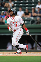 Third baseman Wendell Rijo (11) of the Greenville Drive bats in a game against the Asheville Tourists on Sunday, July 20, 2014, at Fluor Field at the West End in Greenville, South Carolina. Rijo is the No. 18 prospect of the Boston Red Sox, according to Baseball America. Asheville won game two of a doubleheader, 3-2. (Tom Priddy/Four Seam Images)