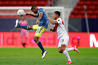 9th July 2021, Brasilia, Federal District, Brazil:  Wilmar Barri Colombia clears from Gianluca Peru during match between Colombia and Peru for 3rd place in Copa America 2021, held at Mane Garrincha stadium, in Brasilia, Federal District