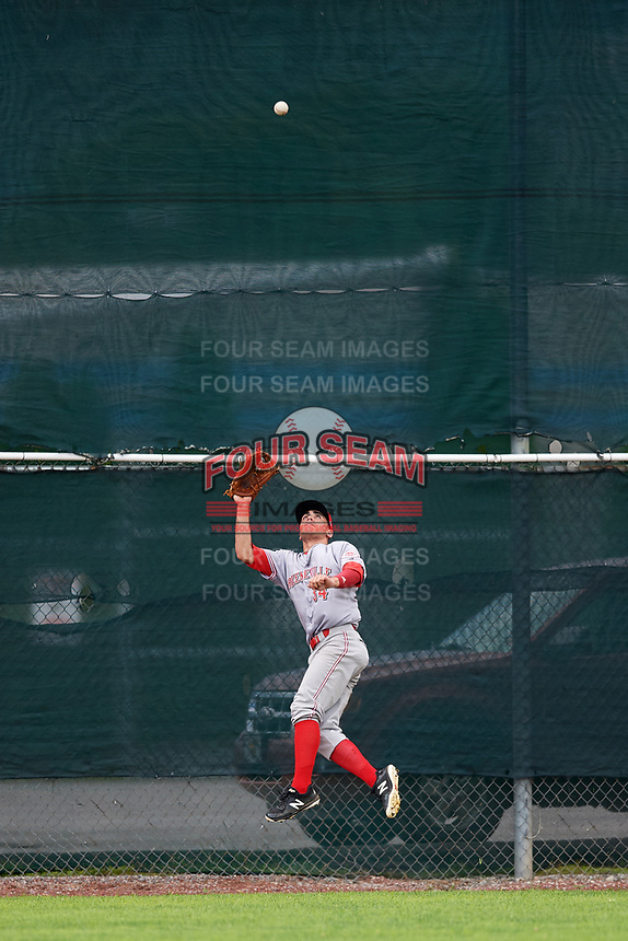 Greeneville Reds center fielder Mike Siani (34) jumps to try to catch a fly ball during the first game of a doubleheader against the Princeton Rays on July 25, 2018 at Hunnicutt Field in Princeton, West Virginia.  Princeton defeated Greeneville 6-4.  (Mike Janes/Four Seam Images)