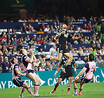 Ambrose Curtis in the air. Hong Kong Sevens, 27 March 2015. NZ beat Scotland in game one 26-7. Photo: Marc Weakley