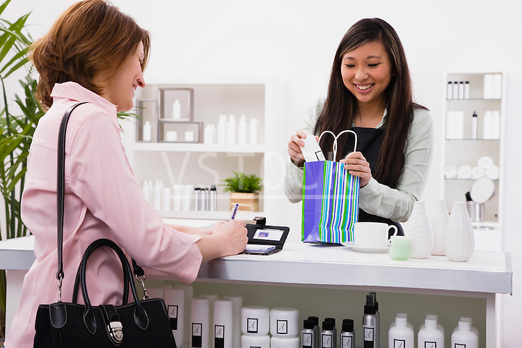 Woman buying cosmetics in store