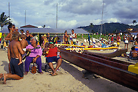 EDITORIAL ONLY. Enjoying an outrigger canoe regatta, Hanalei, Kauai