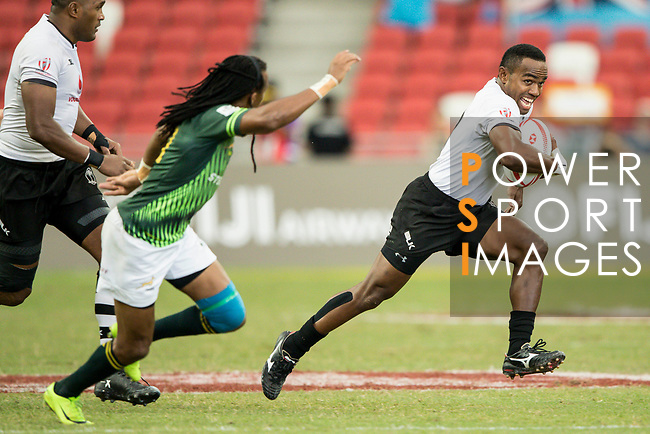 Waisea Nacuqu of Fiji runs with the balls during the match Fiji vs South Africa, Day 2 of the HSBC Singapore Rugby Sevens as part of the World Rugby HSBC World Rugby Sevens Series 2016-17 at the National Stadium on 16 April 2017 in Singapore. Photo by Victor Fraile / Power Sport Images