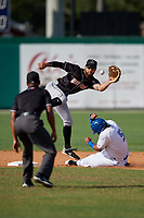 Jupiter Hammerheads second baseman Riley Mahan (2) catches a throw as Norberto Obeso (5) slides in safely on a stolen base during a Florida State League game against the Dunedin Blue Jays on May 15, 2019 at Jack Russell Memorial Stadium in Clearwater, Florida.  Jupiter defeated Dunedin 5-1 in seven innings, the first game of a doubleheader.  (Mike Janes/Four Seam Images)