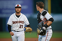 Delmarva Shorebirds pitcher Gray Fenter (21) walks off the field with catcher Adley Rutschman (37) during a South Atlantic League game against the Greensboro Grasshoppers on August 21, 2019 at Arthur W. Perdue Stadium in Salisbury, Maryland.  Delmarva defeated Greensboro 1-0.  (Mike Janes/Four Seam Images)