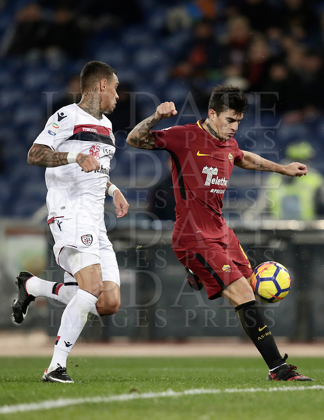 Calcio, Serie A: AS Roma vs Cagliari, Roma, stadio Olimpico, 16 dicembre 2017.<br /> Roma's Diego Perotti (r) in action with Cagliari's Gregory Van Der Wiel (l) during the Italian Serie A football match between AS Roma and Cagliari at Rome's Olympic stadium, December 16, 2017.<br /> UPDATE IMAGES PRESS/Isabella Bonotto