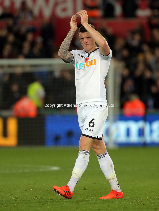 Alfie Mawson of Swansea City applauds home supporters during the Premier League match between Swansea City and Brighton and Hove Albion at The Liberty Stadium, Swansea, Wales, UK. Saturday 04 November 2017