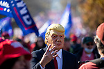 "A person wears a Trump costume during the ""Million MAGA March"" on November 14, 2020 in Washington, D.C.  Thousands of supporters of U.S. President Donald Trump gathered to protest the results of the 2020 presidential election won by President-Elect Joe Biden.  Photograph by Michael Nagle"