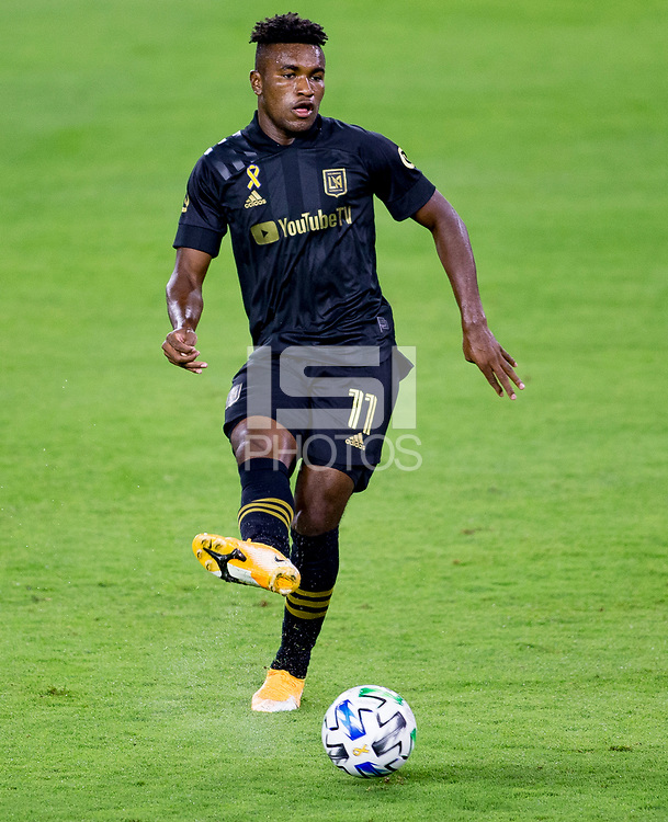 LOS ANGELES, CA - SEPTEMBER 23: Jose Cifuentes #11 of LAFC passes off the ball during a game between Vancouver Whitecaps and Los Angeles FC at Banc of California Stadium on September 23, 2020 in Los Angeles, California.