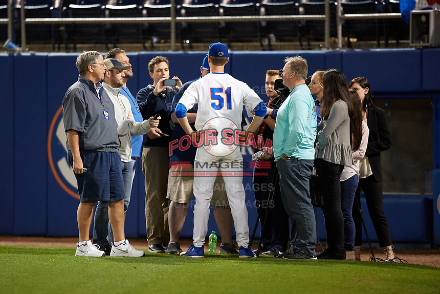 Florida Gators starting pitcher Brady Singer (51) is interviewed by the media after a game against the Siena Saints on February 16, 2018 at Alfred A. McKethan Stadium in Gainesville, Florida.  Florida defeated Siena 7-1.  (Mike Janes/Four Seam Images)