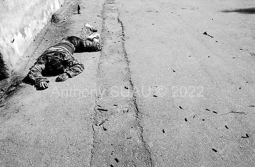 Sukhumi, Abkhazia<br /> September 28, 1993<br /> <br /> A dead Georgian soldier lies in the streets near the Parliament build. Only Abkhazian separatists roam the streets after they captured the city the evening before.