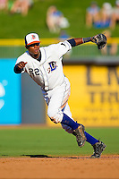 Shortstop Tim Beckham #22 of the Durham Bulls tracks a ground ball against the Charlotte Knights at Durham Bulls Athletic Park on August 28, 2011 in Durham, North Carolina.  The Bulls defeated the Knights in Game One of a double header 4-3 in 8 innings.   (Brian Westerholt / Four Seam Images)