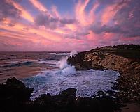 Waves Crashing against Makawehi Bluff at Sunset, Poipu, Kauai, Hawaii, USA.