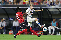CLEVELAND, OHIO - JUNE 22: Aubrey David #2, Paul Arriola #7 during a 2019 CONCACAF Gold Cup group D match between the United States and Trinidad & Tobago at FirstEnergy Stadium on June 22, 2019 in Cleveland, Ohio.
