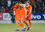 St Johnstone v Dundee United...11.02.12.. SPL.Jon Daly and Milos Lacny celebrate at full time.Picture by Graeme Hart..Copyright Perthshire Picture Agency.Tel: 01738 623350  Mobile: 07990 594431