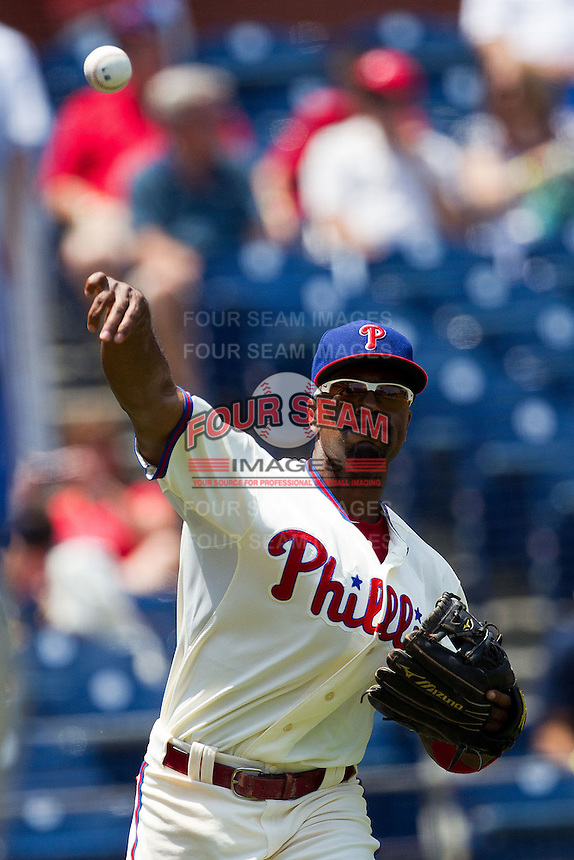 Philadelphia Phillies shortstop Jimmy Rollins #11 warms up before the Major League Baseball game against the Pittsburgh Pirates on June 28, 2012 at Citizens Bank Park in Philadelphia, Pennsylvania. The Pirates defeated the Phillies 5-4. (Andrew Woolley/Four Seam Images).