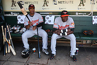 OAKLAND, CA - JUNE 6:  Melvin Mora #6 (left) and Felix Pie #18 of the Baltimore Orioles get ready in the dugout before the game against the Oakland Athletics at the Oakland-Alameda County Coliseum on June 6, 2009 in Oakland, California. Photo by Brad Mangin