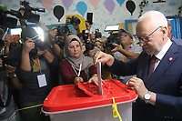 Ennahdha Party leader Rached Ghannouchi casts his ballot at a polling station in the capital Tunis on October 6, 2019,
