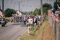 peloton rolling through a rural community<br /> <br /> Stage 7: Fougères > Chartres (231km)<br /> <br /> 105th Tour de France 2018<br /> ©kramon