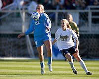 North Carolina Tar Heels midfielder Allie Long (21) and Notre Dame Fighting Irish defender Elise Weber (23). The North Carolina Tar Heels defeated the Notre Dame Fighting Irish 2-1 during the finals of the NCAA Women's College Cup at Wakemed Soccer Park in Cary, NC, on December 7, 2008. Photo by Howard C. Smith/isiphotos.com