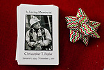 TORRINGTON, CT-122717JS01----Memorial cards for late  Torrington Fire Department Deputy Chief, Chris Pepler, sit on the table of who family's home in Torrington Thursday. Jim Shannon Republican-American