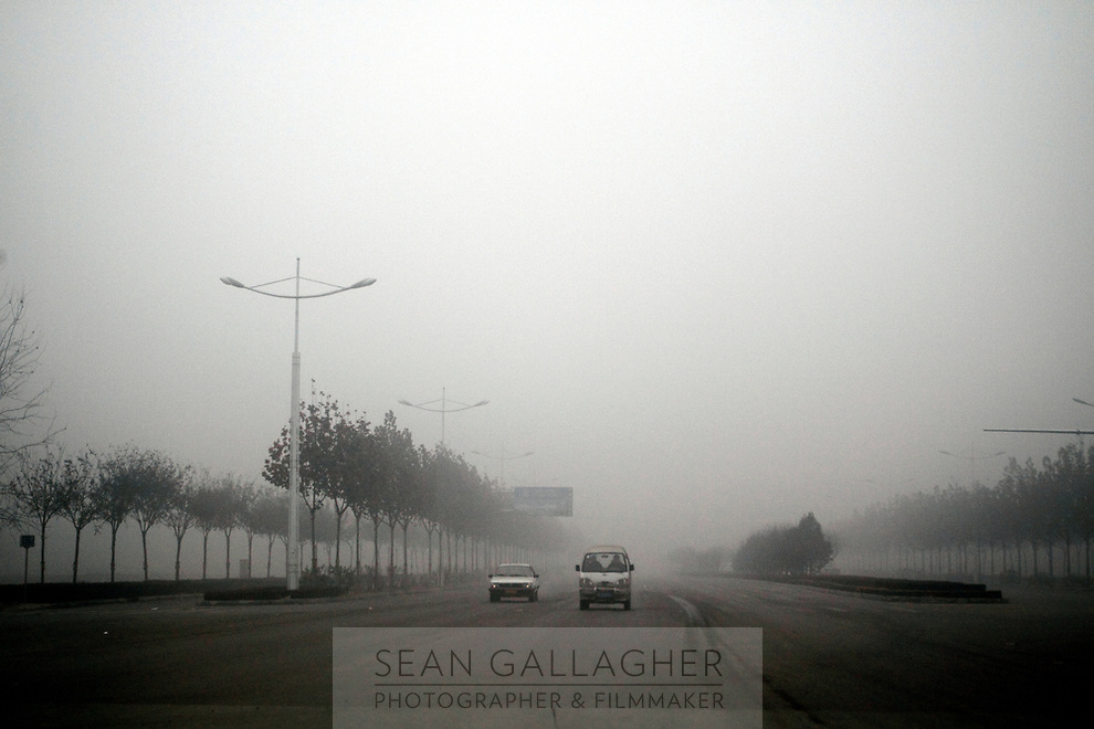 CHINA. Hebei. Smog hangs over Baoding City near Beijing, the world's first 'carbon positive' town. The town's main industires focus on producing wind and solar technologies. 2009