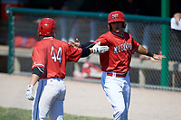 Batavia Muckdogs Michael Donadio (7) high fives Gunnar Schubert (44) after scoring a run during a game against the State College Spikes on July 8, 2018 at Dwyer Stadium in Batavia, New York.  Batavia defeated State College 8-3.  (Mike Janes/Four Seam Images)