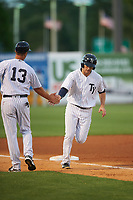 Tampa Yankees manager Pat Osborn (13) low fives Austin Aune (21) as he rounds the bases on a Michael O'Neill (not shown) home run during a game against the Dunedin Blue Jays on April 19, 2016 at George M. Steinbrenner Field in Tampa, Florida.  Tampa defeated Dunedin 12-7.  (Mike Janes/Four Seam Images)