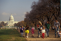 AJ3295, The Mall, Washington, District of Columbia, D.C., People walk with their children on the Mall lined with trees with the U.S. Capitol Building in the background in the nations capital Washington, DC.