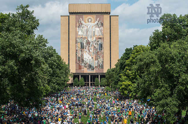 Aug. 30, 2014; Fans gather on the library quad for the player walk..Photo by Matt Cashore
