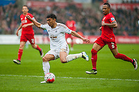 Jefferson Montero of Swansea City  crosses the ball during  the Barclays Premier League match between Swansea City and Liverpool played at the Liberty Stadium, Swansea  on May the 1st  2016