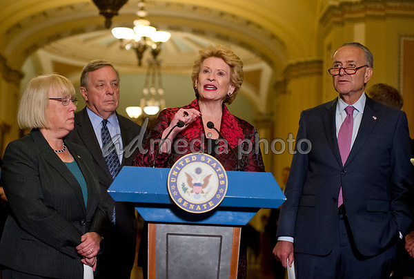 United States Senator Debbie Stabenow (Democrat of Michigan) speaks to reporters following the Democratic Party luncheon in the United States Capitol in Washington, DC on Tuesday, June 27, 2017.  From left to right: US Senator Patty Murray (Democrat of Washington), US , Senate Minority Whip Dick Durbin (Democrat of Illinois), Senator Stabenow, and US Senate Minority Leader Chuck Schumer (Democrat of New York). Photo Credit: Ron Sachs/CNP/AdMedia