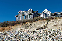 Beach house threatened by ongoing coastal erosion, Stonewall Beach, Chilmark, Martha's Vineyard, Massachusetts, USA