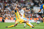 Isco Alarcon (r) of Real Madrid fights for the ball with Carlos Roberto Da Cruz Junior, Cariao, of APOEL FC during the UEFA Champions League 2017-18 match between Real Madrid and APOEL FC at Estadio Santiago Bernabeu on 13 September 2017 in Madrid, Spain. Photo by Diego Gonzalez / Power Sport Images