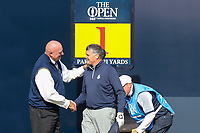 200719 | The 148th Open - Day 3<br /> <br /> The first game marker Royal Prortrush professional Gary McNeill is welcomed onto the 1st tee by the starter during the 148th Open Championship at Royal Portrush Golf Club, County Antrim, Northern Ireland. Photo by John Dickson - DICKSONDIGITAL