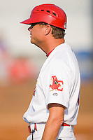 Johnson City Cardinals manager Mike Schildt #8 coaches third base during an Appalachian League game against the Elizabethton Twins at Howard Johnson Field July 3, 2010, in Johnson City, Tennessee.  Photo by Brian Westerholt / Four Seam Images