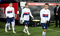 SWANSEA, WALES - NOVEMBER 12: Giovanni Reyna #7, Antonee Robinson #5, Tyler Adams #4 and Sergino Dest #2 of the United States walking out during a game between Wales and USMNT at Liberty Stadium on November 12, 2020 in Swansea, Wales.