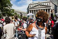 NEW YORK, NEW YORK - June 20: A woman sings with a group of musicians participating in a protest in Foley Square on June 20, 2020. Juneteenth commemorates June 19, 1865, when a Union general read orders in Galveston, Texas stating all enslaved people in Texas were free according to federal law. (Photo by Pablo Monsalve / VIEWpress via Getty Images)