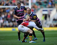 Mike Tindall of Gloucester Rugby is tackled by Elliot Daly of London Wasps as James Hudson of Gloucester Rugby looks on during the Aviva Premiership match between London Wasps and Gloucester Rugby at Twickenham Stadium on Saturday 19th April 2014 (Photo by Rob Munro)