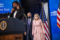 US President Joe Biden, with First Lady Dr. Jill Biden, listen to remarks by Margaret Purce, a member of the U.S. Soccer Women's National Team, during an event to mark Equal Pay Day in the State Dining Room of the White House in Washington, DC, USA, 24 March 2021. Equal Pay Day marks the extra time it takes an average woman in the United States to earn the same pay that their male counterparts made the previous calendar year.<br /> CAP/MPI/RS<br /> ©RS/MPI/Capital Pictures