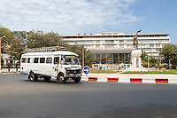 Dakar, Senegal.  Soweto Square (Place Soweto) with National Assembly Building in background, local transport bus in foreground.