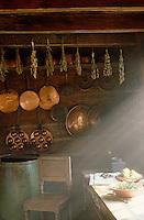 A shaft of sunlight illuminates the kitchen table