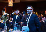 St Johnstone FC Scottish Cup Celebration Dinner at Perth Concert Hall...01.02.15<br /> Saints pastor David Barrie playing Heads and Tails<br /> Picture by Graeme Hart.<br /> Copyright Perthshire Picture Agency<br /> Tel: 01738 623350  Mobile: 07990 594431